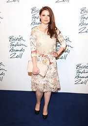 Hayley Atwell wore an intricate Mulberry print dress for the BFA red carpet. The design featured a colorful abstract print intertwined with a sheer organza embroidered lace.
