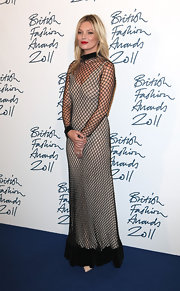 Kate Moss looked like fashion royalty in a floor-length fishnet gown for the British Fashion Awards.
