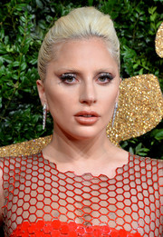 Lady Gaga styled her look with a gorgeous pair of dangling diamond earrings.