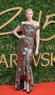 Gwendoline Christie glimmered on the British Fashion Awards red carpet in a metallic off-the-shoulder gown by Vivienne Westwood.