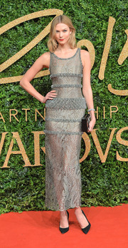 Karlie Kloss kept it classy in a paisley-patterned lace dress by Chanel at the British Fashion Awards.