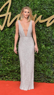 Rosie Huntington-Whiteley looked head-to-toe flawless in a silver Burberry sequin gown with a navel-skimming neckline during the British Fashion Awards.