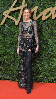 Cheryl Fernandez-Versini donned a sexy yet tasteful floral-sequined, sheer dress by Topshop for the British Fashion Awards.