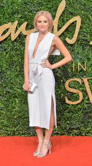 Pixie Lott flashed some (front and side) cleavage in an Issa deep-V LWD with an open back during the British Fashion Awards.