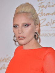 Lady Gaga amped up the glam factor with a pair of massive diamond hoops at the British Fashion Awards.