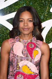 Naomie Harris styled her locks into a face-framing center-parted 'do for the British Fashion Awards.