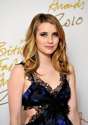 Emma Roberts flaunted her radiant honey-blond curls while attending the British Fashion Awards.