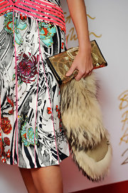 Yasmin Le Bon added a bit of glimmer to her graphic print dress with a luxe looking gold sequined clutch.
