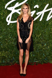 Poppy Delevingne chose a pair of embellished black Nicholas Kirkwood pumps to team with her sexy dress.