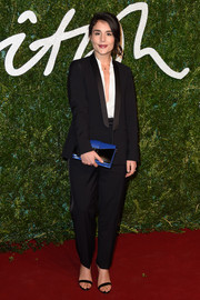 Jessie Ware rocked a black tuxedo with a buttoned-down-to-there shirt during the British Fashion Awards.