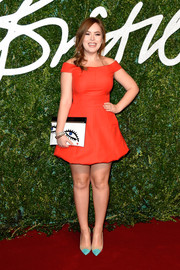 Tanya Burr looked ultra girly in a red Dior off-the-shoulder mini dress during the British Fashion Awards.