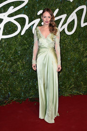Laura Haddock looked very ladylike at the British Fashion Awards in a mint-green wrap gown with long lace sleeves.