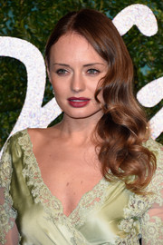 Laura Haddock amped up the sweetness with a curly side sweep paired with a lace-trimmed dress during the British Fashion Awards.