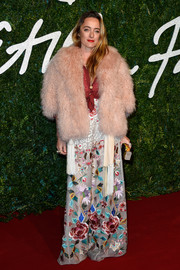 Alice Temperley layered a shaggy pink fur coat over a floral gown for the British Fashion Awards.