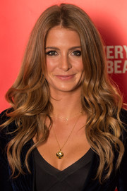 Millie Mackintosh beams with this long wavy hairstyle that shows off her glowing locks.