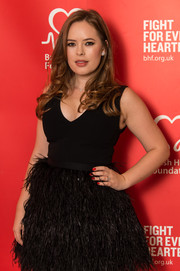 Tanya Burr went for a glamorous look with long curls framing her face at the British Heart Foundation's Tunnel of Love fundraiser.