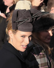 Zara Phillips accessorized with a fancy gray hat for Christmas Day service.