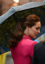 Kate Middleton swept her hair back into a simple wavy ponytail for her visit to the September 11 Memorial Museum.