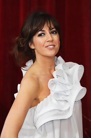 Sheree Murphy paired her ruffled one-shouldered  dress with a messy updo.