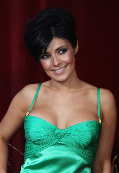 Actress Kym Marsh paired her kelly green satin dress with a classic loose bun, which showed off her flawless makeup.