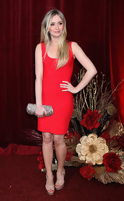 Sammy Winward paired her little red dress with a dazzling gemstone inlaid clutch.