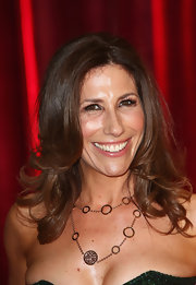 An elegant gold chain necklace adorned Gaynor Faye's decolletage when she attended the British Soap Awards.