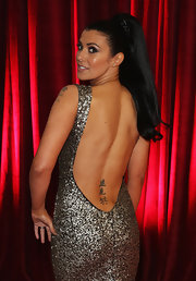 Kym Lomas put her Chinese character tattoo on display with this backless gown at the British Soap Awards.