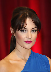 Paula Lane topped off her flawless look with a teased ponytail and center-parted bangs at the British Soap Awards.