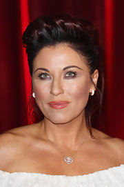 Jessie Wallace was edgy-glam at the British Soap Awards with this towering pompadour.