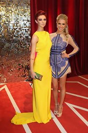 Lucy Dixon sported a lovely mix of colors with her yellow gown and beaded green and gold clutch at the British Soap Awards.