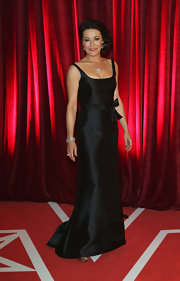 Amanda Donohoe looked timeless in a bow-adorned black evening dress at the British Soap Awards.