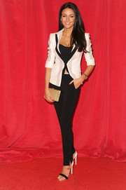 Michelle Keegan accessorized her look with an elegant gold box clutch.