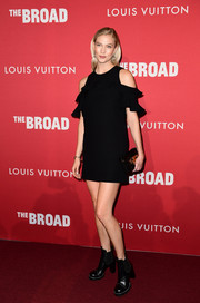 Karlie Kloss toughened up her flirty dress with a pair of studded black boots, also by Louis Vuitton.