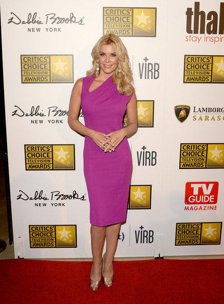 McKenzie Westmore chose an electric purple cocktail dress with an asymmetrical neckline for her look on the red carpet.