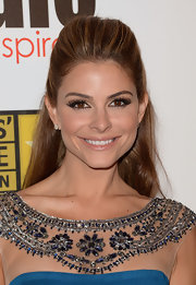 Maria Menounos pulled back her caramel locks into this super pretty classic half up, half down 'do.