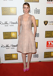 Sarah Paulson's nude lace dress had a soft and romantic touch on the red carpet.