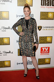 Judy Greer sported a colorful floral long-sleeve dress with black paneling.