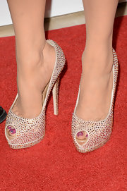Marie Osmond added some sparkle to her toes with this pair of nude bedazzled peep-toe pumps.