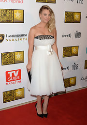 Kaley Cuoco chose a soft white strapless dress with a beaded bust and tied ribbon waist for her look at the Critics' Choice Television Awards.