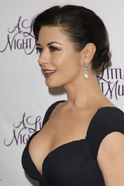 "Catherine Zeta Jones showed off her sleek bun while attending ""A Little Night Music"" Broadway opening."