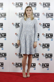 Saoirse Ronan chose a loose baby-blue floral dress for her 'Brooklyn' photocall look.