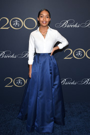 Yara Shahidi dressed up her shirt with a blue ball skirt, also by Zac Posen.