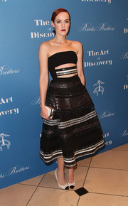 Jena Malone added more shine with a metallic clutch.