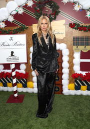 Rachel Zoe went androgynous in a slouchy black suit from her label at the Brooks Brothers Holiday celebration.