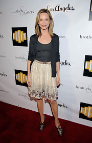 Calista Flockhart kept her red carpet look casual but classy with this lace knee-length skirt.