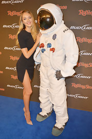 Candice canoodled the Axe astronaut in this little black dress with a zippered hip-high slit.