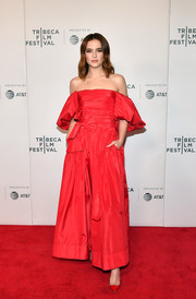 Zoey Deutch chose a princess-worthy red off-the-shoulder gown by Valentino for the Tribeca Film Festival premiere of 'Buffaloed.'