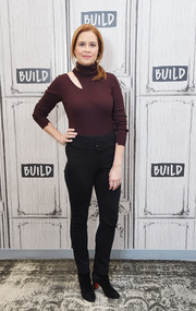 Black ankle boots by Christian Louboutin rounded out Jenna Fischer's cold-weather look.