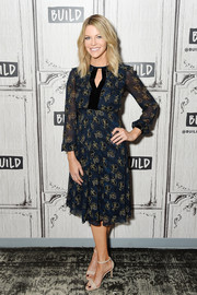 Kaitlin Olson kept it feminine and classic in a navy keyhole-neckline print dress while visiting the Build Series.