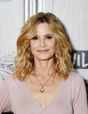 Kyra Sedgwick accessorized with a classic heart pendant.